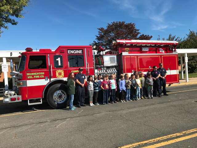 kids-with-the-firetruck-and-people
